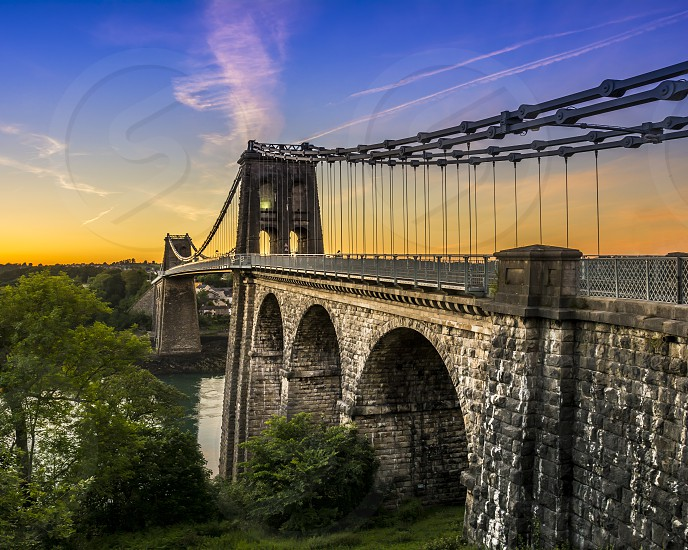 The Menai bridge connecting Anglesey island with mainland in United Kingdom photo