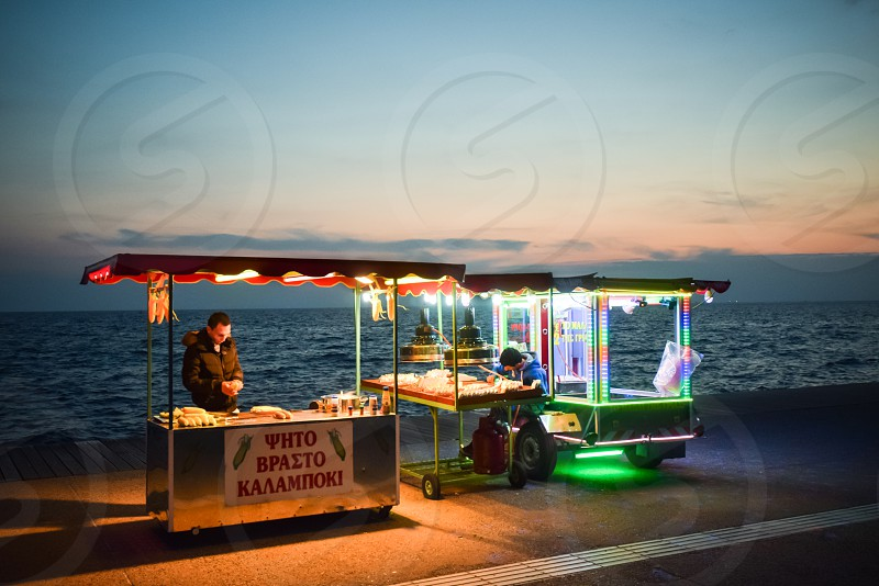 Food Street Corn And Nuts Vendors Business Owners At Sunset photo