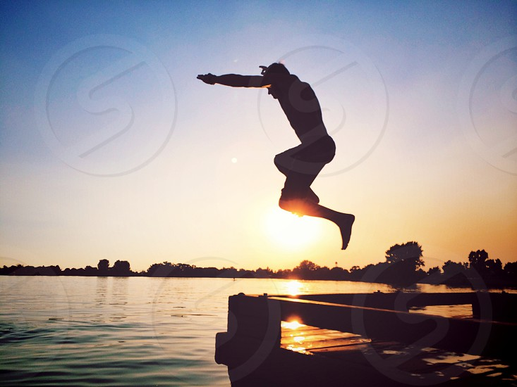 person jumping on water photo