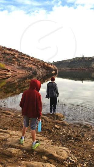 Youth and a mountain lake reflection photo