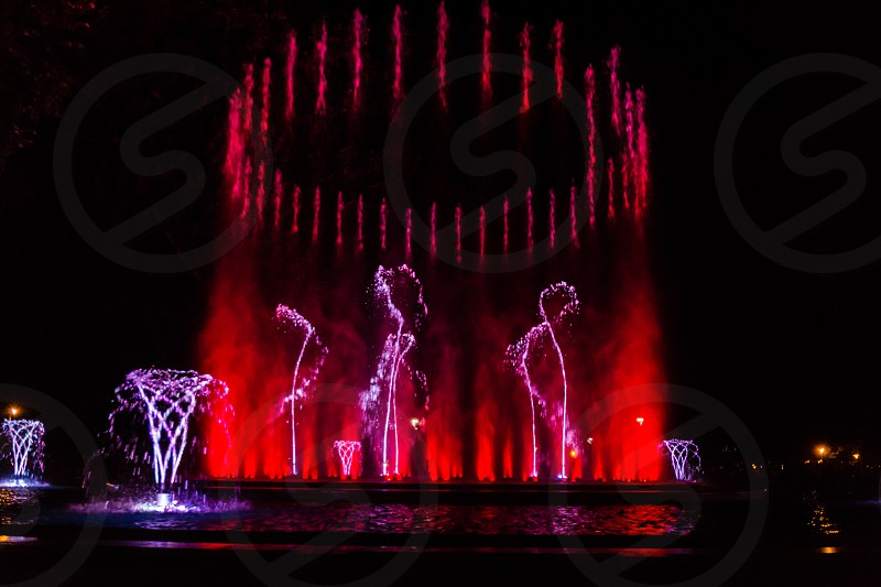 Colorful musical fountain in Margaret Island Budapest Hungary at night photo