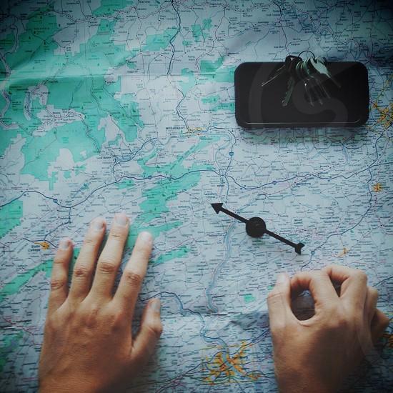 compass on map beside keys photo