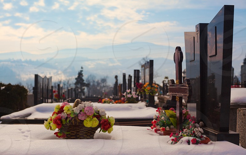 Details of an orthodox Christian cemetery during winter day.  photo