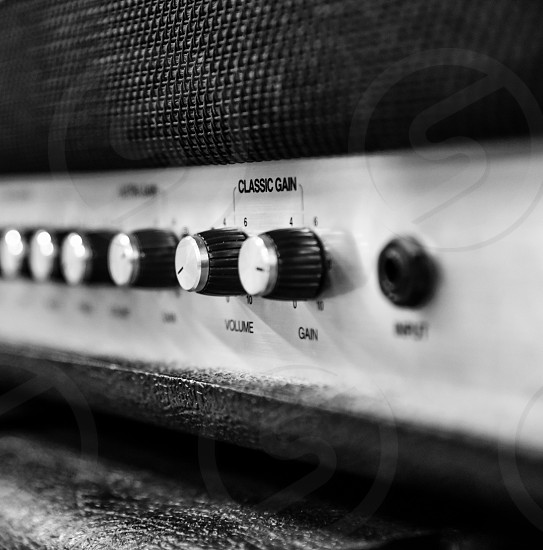 silver and black amp control knobs photo