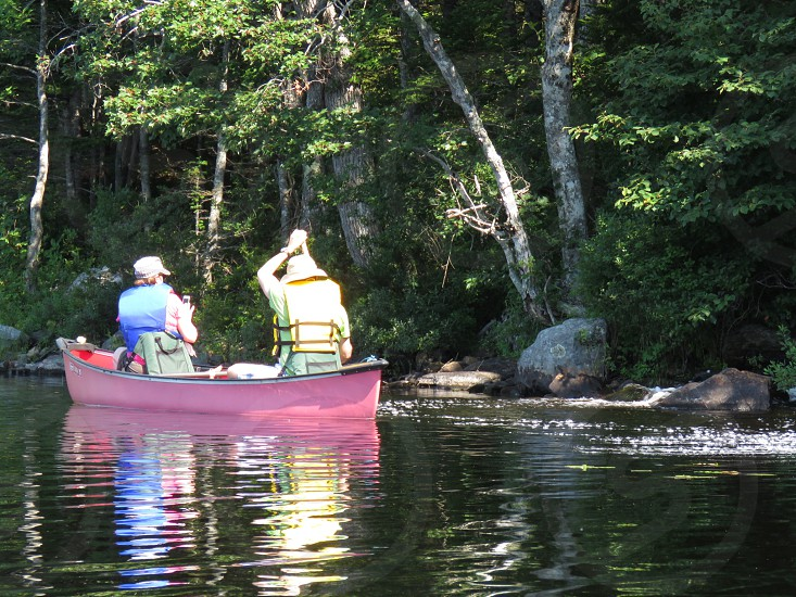 Couple canoe paddle sunny dawn summer lake water picture hats red canoe life vests office love landscape trees sunbeaming adventure outdoors nature photo