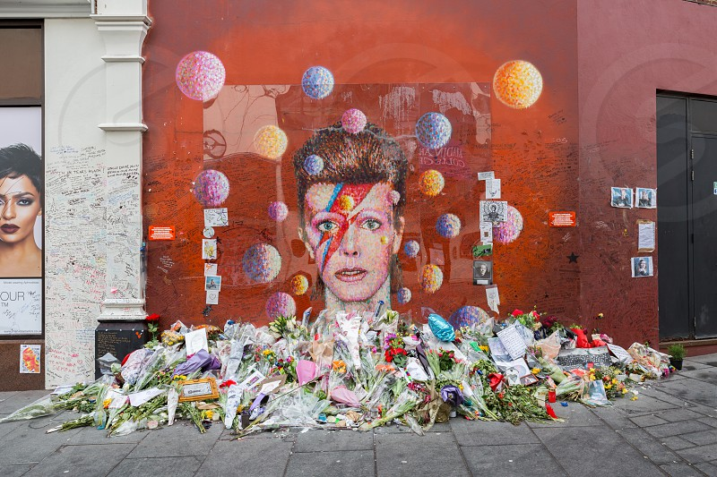 Graffiti of David Bowie in Brixton London Mural has been the centre of a shrine in his memory photo