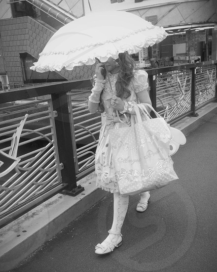woman in white puff sleeved tea length dress photo