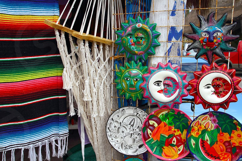 Mexican traditional handcrafts like hammock serape and ceramics aztec sun indian photo