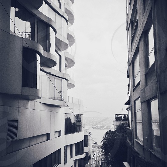 gray scale photo of two concrete buildings photo