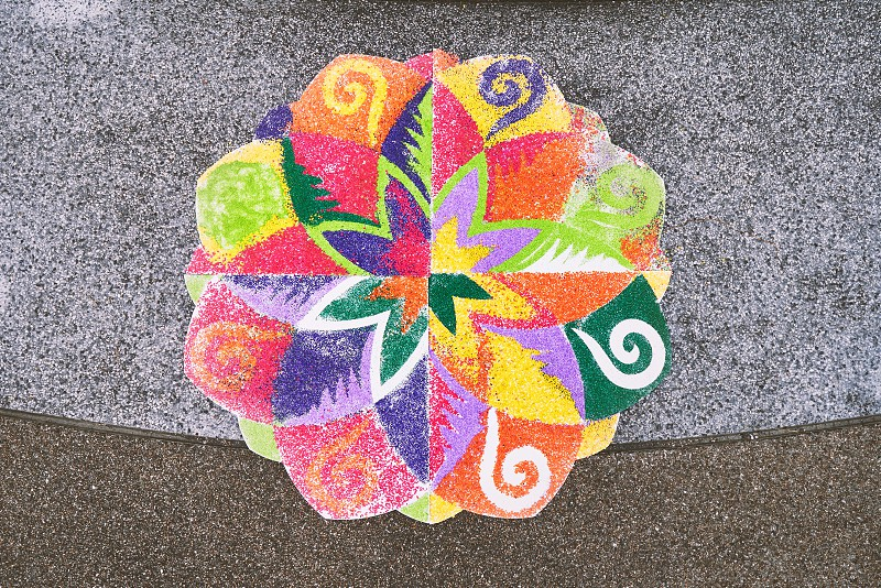 The rangoli or sand art or rice art with colorful decoration on the floor one of the traditional part of indian wedding ceremony photo