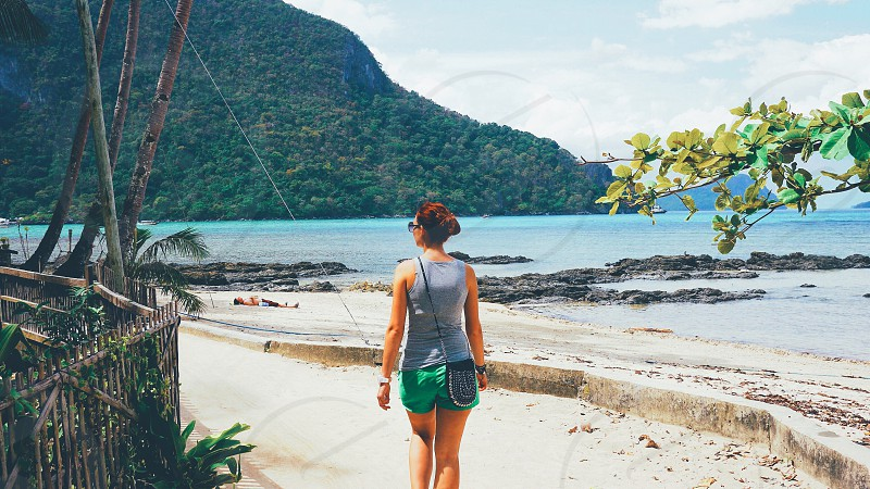 Woman walking while travelling in the Philippines photo
