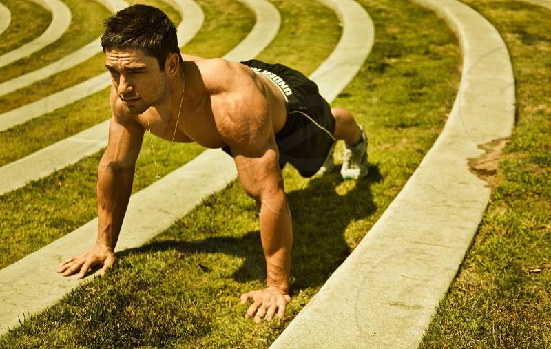 man doing push ups photo