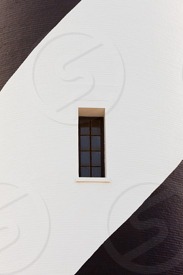 Small narrow window architectural abstract of Cape Hatteras Lighthouse tower of Outer Banks Island near Buxton North Carolina USA photo