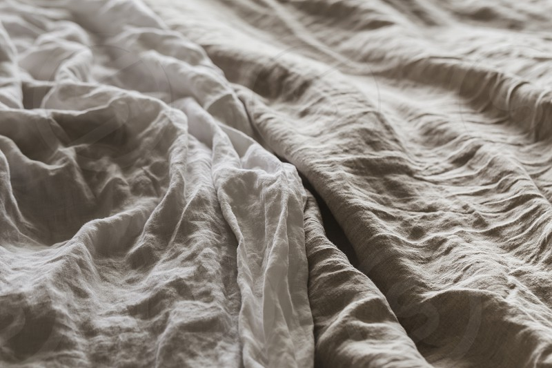 bedlinen bed linen sheets crumpled unmade fabric texture natural flax photo