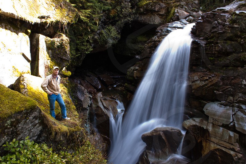 Standing by a Waterfall photo