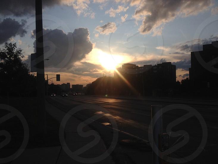 Down the street sun setting photo