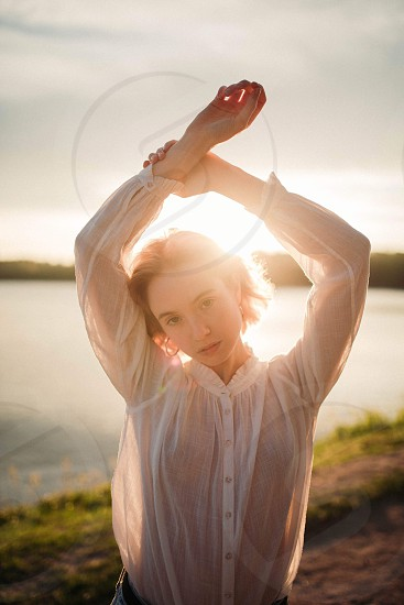 Sunset golden hour girl model pose water reservoir nature blonde fashion editorial pixie photo