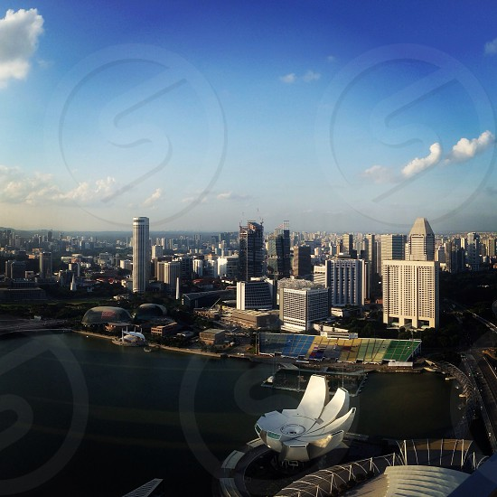 The view from the top of the Marina Bay Sands Hotel Bar at 57. Singapore skyline. photo