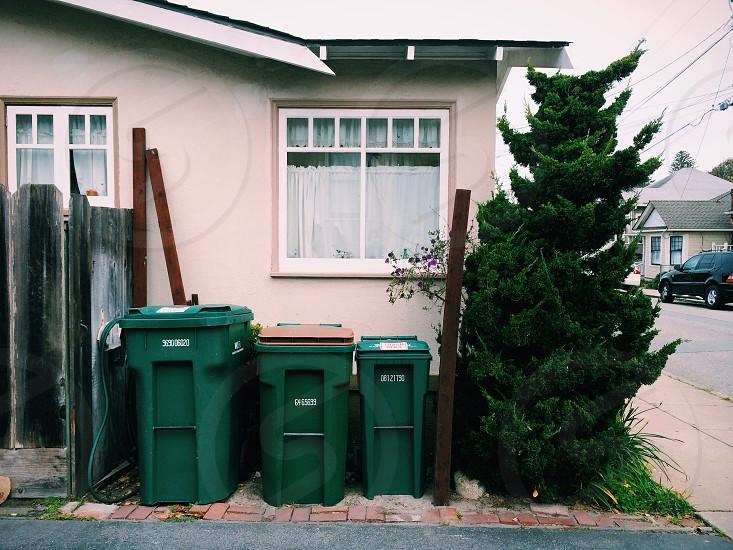 green plastic trash bin photo