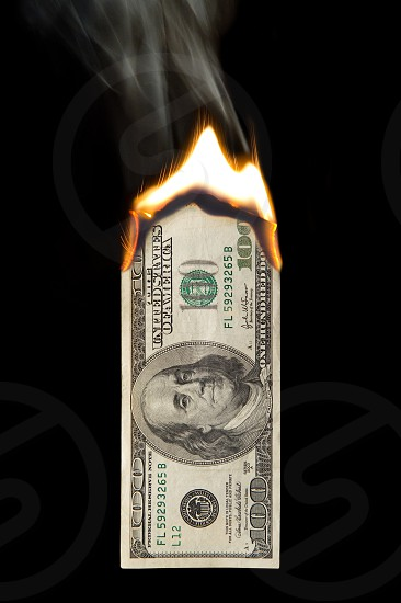 background; bank; bank-note; banknote; bankruptcy; bill; black; burn; business; careless; cash; commercial; concept; copy-space; credit; currency; debt; deduction; dollar; dues; duty; economy; excess; expense; finance; fire; flame; gambling; green; hundred; inflation; isolated; loan; luxury; money; note; paper; problem; reckless; rich; risk; ruin; savings; security; spend; tallage; tax; waste; wasteful; wealth photo
