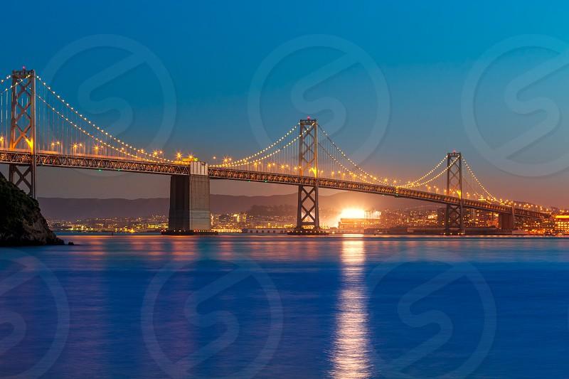 Bay Bridge at sunset in San Francisco from Treasure Island California USA photo