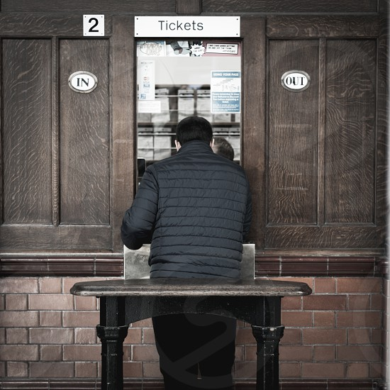 Buying a rail ticket. Victoria station. Manchester UK. photo