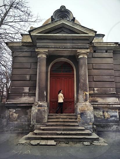Girl near red door photo