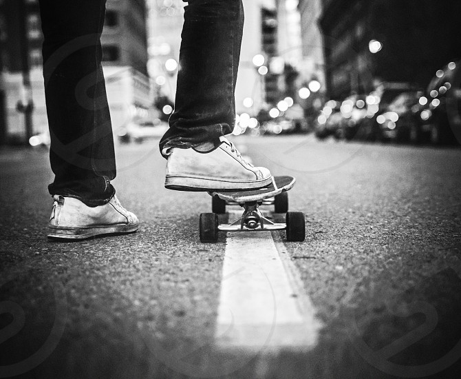 skateboard; street; city; boy; night; skate; young; lifestyle; sport; urban; skateboarder; background; man; male; outdoor; culture; active; board; action; town; wheel; extreme; dangerous; skater; skatepark; scene; trick; skateboarding; asphalt; shoes; style; leisure; youth; person; summer; modern; casual; cool; hobby; deck; hipster; gumshoes; standing; road; feet; instagram; filtered; retro; vintage; app bw black and white high iso    photo