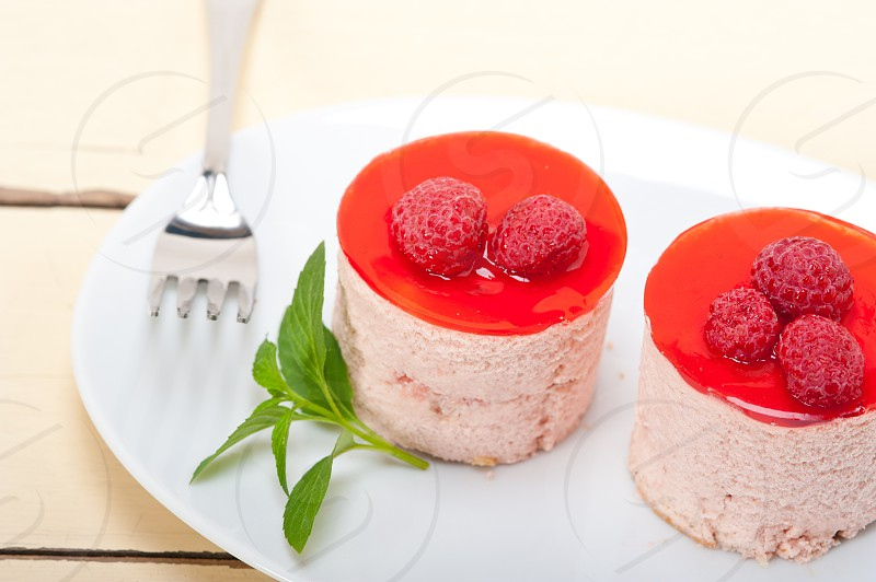 fresh raspberry cake mousse dessert round shape with mint leaves photo