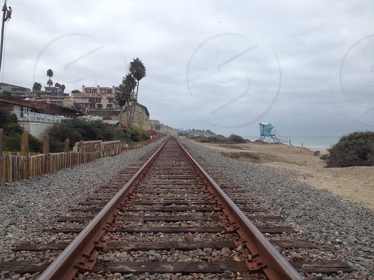 train tracks near houses photo