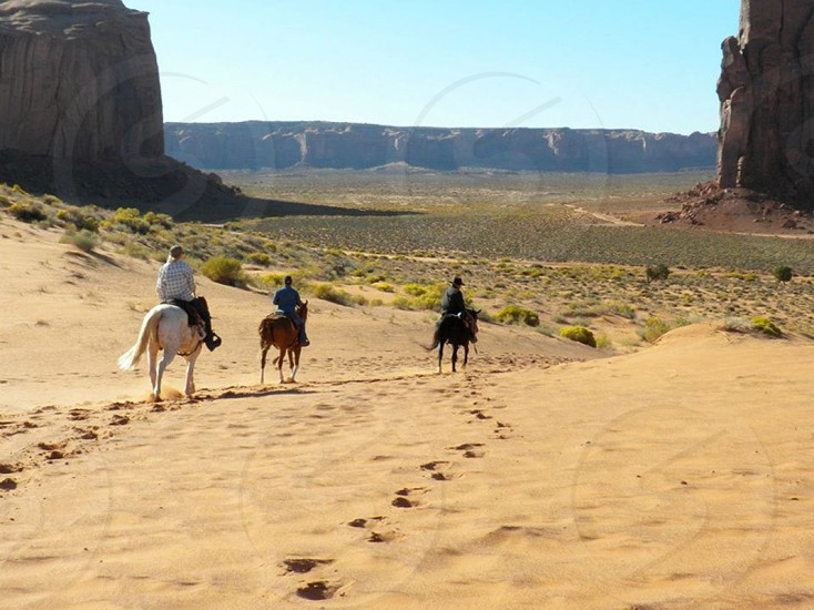 Horseback riders in Monument Valley.  photo