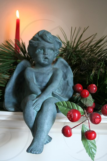 Christmas angel cherub red berries red candle fireplace mantel decor photo