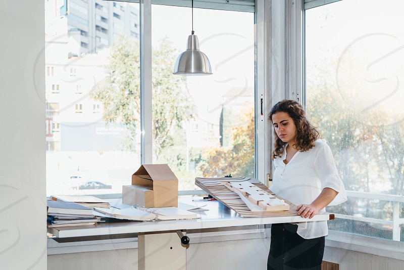 Portrait of architect with architectural model in office photo