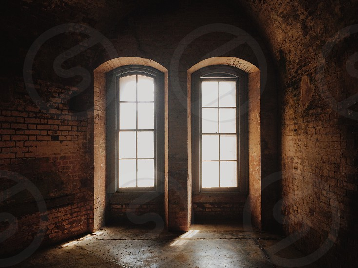 Two sun windows with arches photo