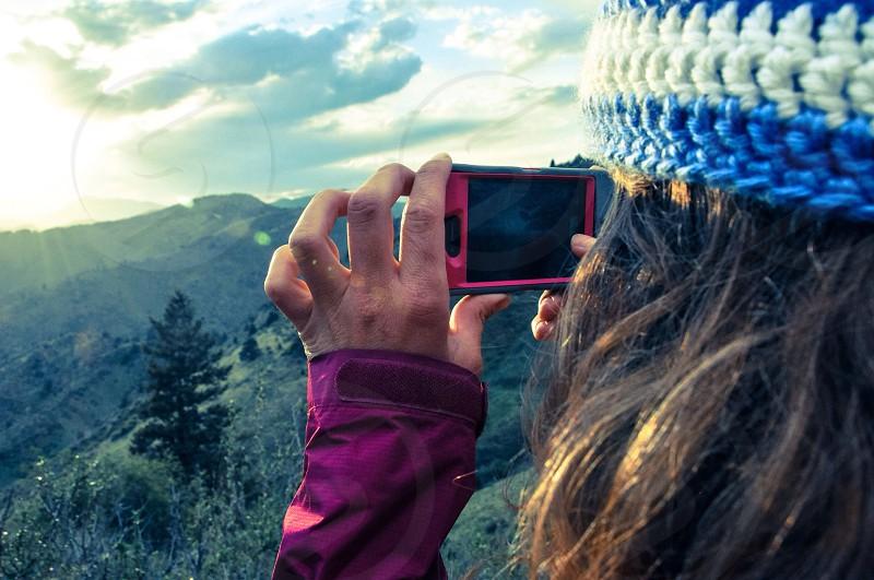 female taking photo photo