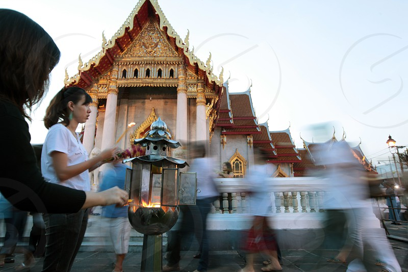 a traditional Buddhism ceremony at the Wat Benchamabophit  in Banglamphu in the city of Bangkok in Thailand in Suedostasien. photo