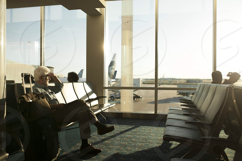 Father waiting for plane.  photo