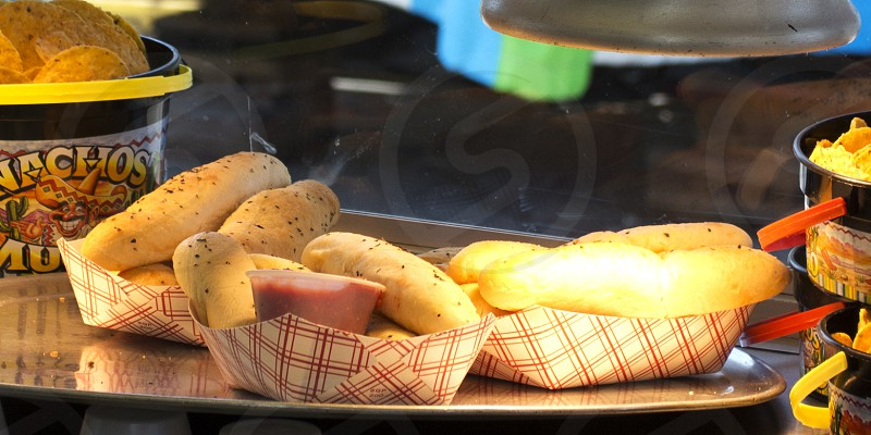 Hot breadsticks at fair or festival with marinara dipping sauce photo