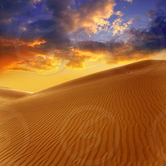 Desert sand dunes in Maspalomas sunset Gran Canaria at Canary islands photo