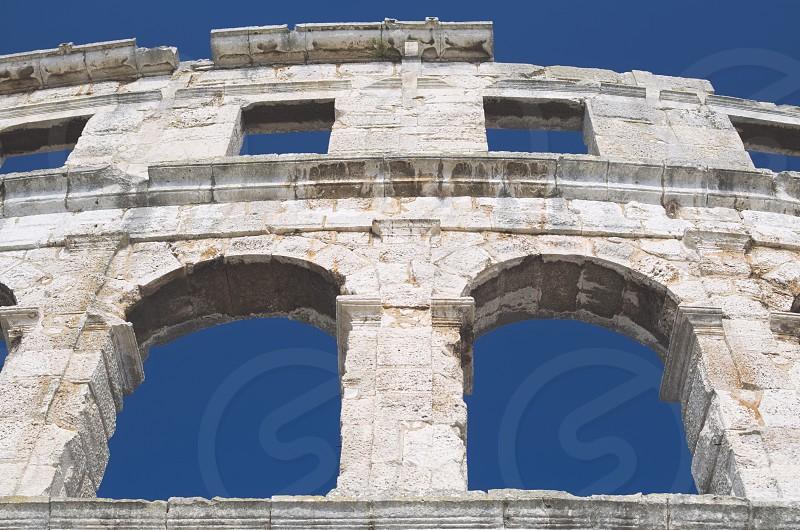 Ancient Roman Window and Facade Architecture Closeup photo