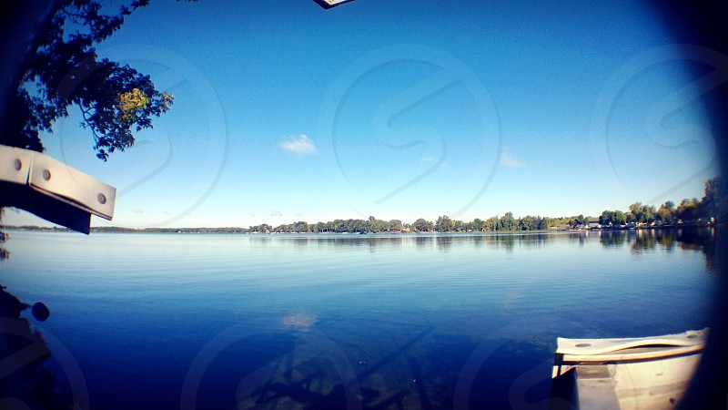 Fish eye lens out on a crystal clear blue lake. photo