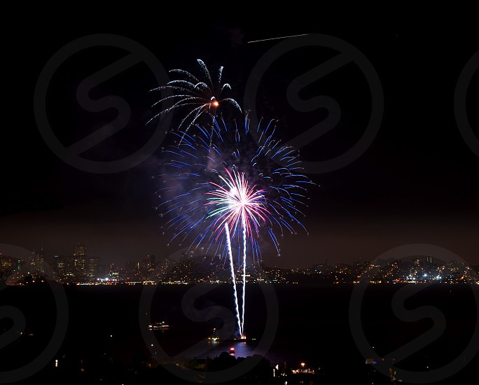 Fireworks on Richardson Bay with SF in background.  photo
