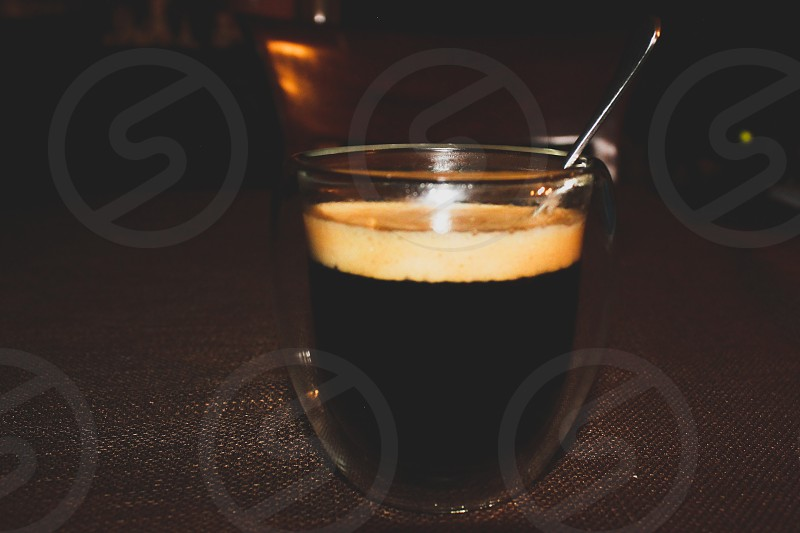 minimal of shot of espresso against brown background photo
