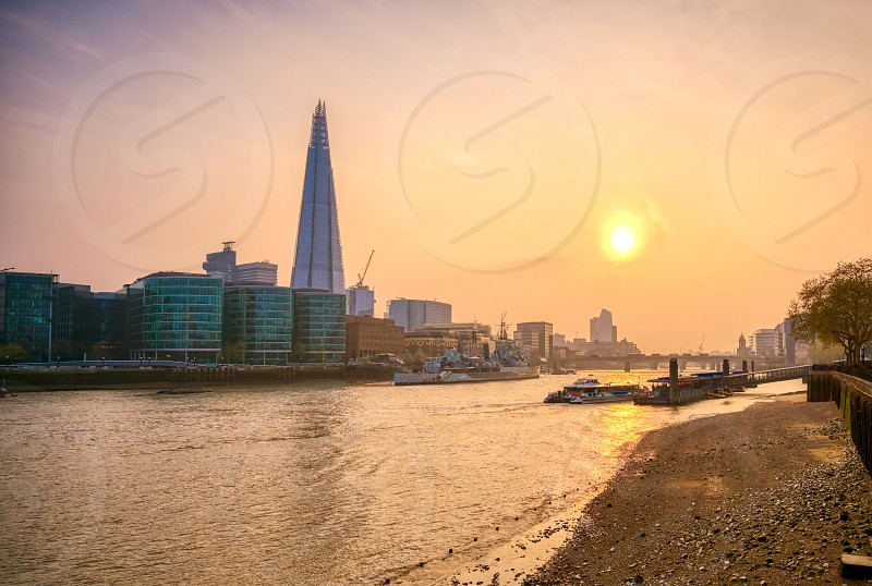 A view along the River Thames on at dusk in London UK. photo
