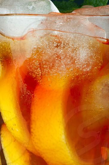 Ice tea with lemon.Closeup glass ice tea with ice cubes and mint. photo