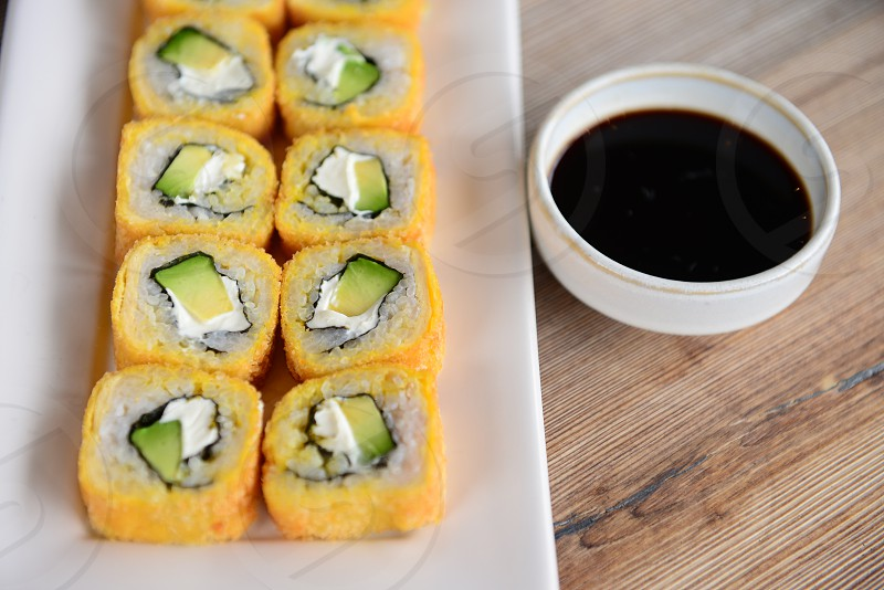 Shoot from a double cream cheese sushi roll. photo