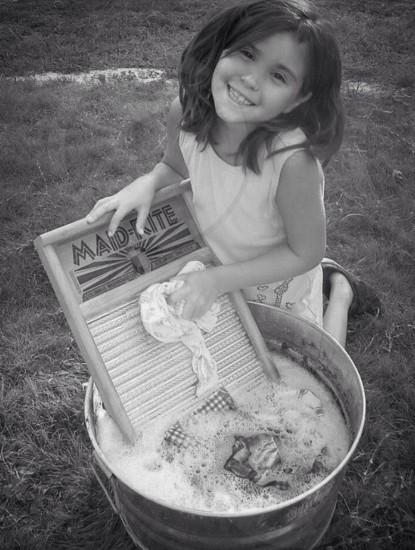 girl washing clothes photo