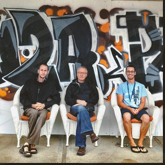 Family men sitting in chairs mural  photo