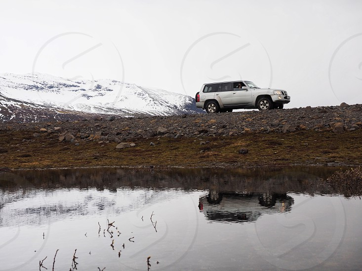Car roadtrip nature Iceland mountain water reflection photo
