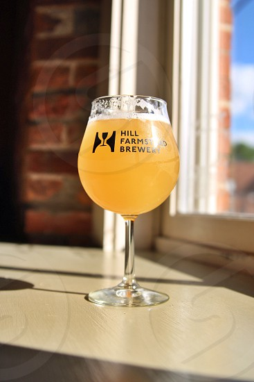 clear Hill Farmstand Brewery wine glass with beer photo
